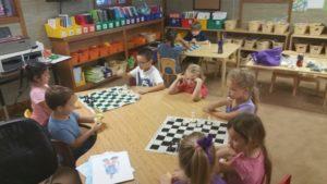 9 children playing chess